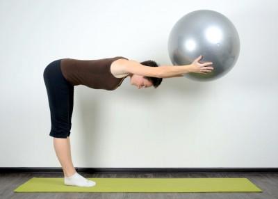 Вытяжение спины в положении стоя